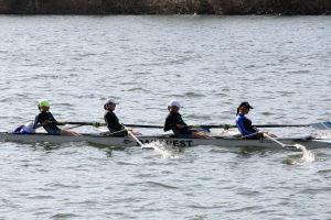 Oakcrest Crew: The Oakcrest High School lightweight four, from right to left: Connie Capone, Nicole Littlefield, Morgan Osborn, Danielle LaPergola, and coxswain Rebecca Adamo, compete at the third Manny Flick/Horvat Series regatta on the Schuylkill River in Philadelphia on April 7.  - Photo by Michelle Phy