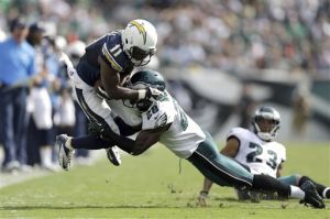 Earl Wolff: San Diego Chargers' Eddie Royal, left, is tackled by Philadelphia Eagles' Earl Wolff last season. Wolff is enjoying the opportunity to learn from recent free-agent acquisition Malcolm Jenkins. - Matt Rourke, Sept. 15