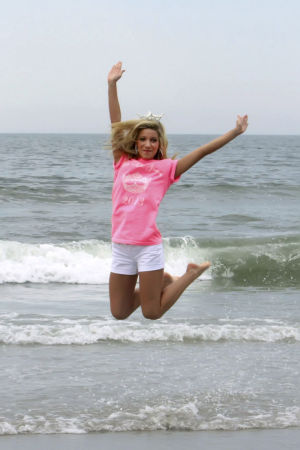 Miss New Jersey: OCEAN CITY, NJ - JUNE 16: Cara McCollum, newly crowned Miss New Jersey 2013 does a water kick on June 16, 2013 in Ocean City, United States. (Photo by Donald Kravitz - Donald Kravitz