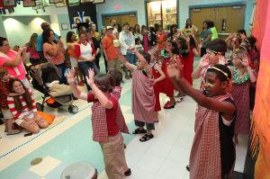 Acbp J12 Brigantine Arts Night: Second-grader Khairi Naji-Robinson, 8, of the south end of Brigantine, front right, dances a 'Twaingia' welcome dance June 6 duringBrigantine Elementary School Arts Night, An African Safari in Brigantine.  - Sean M. Fitzgerald