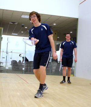St. Augustine Squash Match: St. Augustine's Matt Spiers, 18 of Somers Point foreground and Austin King, 18 of Harbor Township background warm up before their squash match against St. Joe Prep of Philadelphia at Greate Bay Racquet & Fitness in Somers Point Tuesday, Feb, 18, 2014. - Edward Lea