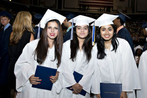 ATLANTIC CITY GRADUATION: On June 24th at the Atlantic City Boardwalk hall, the Atlantic City High School graduation is under way. (l-r) Seniors Huma Adil, 19, Faryal Ahmed, 17, and Sameeha Ahmed, 18, are all smiles having just received their diplomas. - Matthew Strabuk