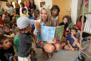 Miss NJ In Margate: Cara McCollum, Miss New Jersey, originally from Forrest City, Arkansas , reads to children at the Margate Library, in Margate, Wednesday July 10, 2013. - Vernon Ogrodnek