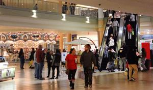 Last-minute shoppers brave rain to pack mall area