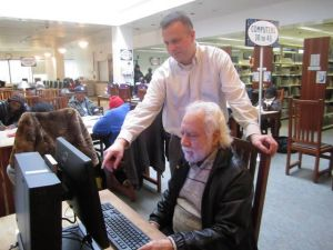 A.C. Library Adds Pronunciator  To Its Language-learning Offerings: Don Latham, the public information officer at the Atlantic City Free Public Library, helped Spanish-speaking library member, Jose Bruno Tellez, 73, of Atlantic City, with the library's latest language-learning system, Pronunciator.  - Caitlin Honan