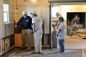 Steve-cookies: Rich Richmond, of Linwood, left, points out repairs needed to Greg Kedziora, of Galloway Township, and Rodrigo Sanchez, of Atlantic City, Wednesday Nov. 14, 2012, at Steve and Cookie's Restaurant in Margate. The restaurant is currently being renovated due to flooding from Hurricane Sandy. (The Press of Atlantic City/Staff Photo by Michael Ein)  - Michael Ein