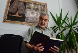 RAMADAN STARTS: Fathi Safi of Atlantic City reads the Koran before prayer. Tuesday July 9 2013 Prayers begin to mark Ramadan at Masjid At-Taqwa in Atlantic City. (The Press of Atlantic City / Ben Fogletto) - Ben Fogletto