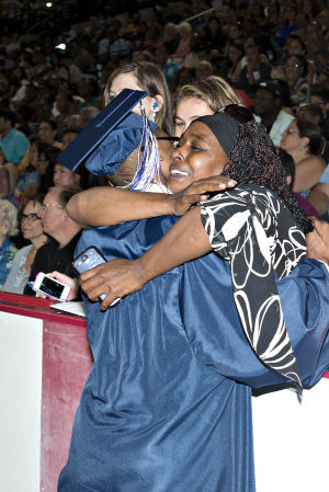 ATLANTIC CITY GRADUATION: On June 24th at the Atlantic City Boardwalk hall, the Atlantic City High School graduation is under way. Quashawn Hemphill, 17, sneaks in a hug from his mom Quanda, an Atlantic City resident, on his way back to his chair after having received his diploma. - Matthew Strabuk