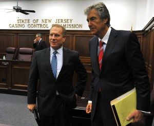 Hartmann: Jeff Hartmann, Interim Chief Executive Officer at Revel, left, walks with Attorney Lloyd Levenson, Tuesday March 19, 2013, following a special meeting with the Casino Control Committee to allow him to operate in Atlantic City. (The Press of Atlantic City/Staff Photo by Michael Ein)  - Michael Ein