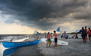Bill Kuhn Brigantine Races: Crews get ready for the races as a storm front moves in overhead. Monday July 8 2013 Chief Bill Kuhn Brigantine Beach Patrol Invitational Races in Brigantine. (The Press of Atlantic City / Ben Fogletto) - Ben Fogletto