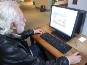 A.C. Library Adds Pronunciator  To Its Language-learning Offerings: Jose Bruno Tellez, 73, a recent retiree, uses his free time impoving his English, making use of Pronunciator, the newest language-based eResource to become available at the library.  - Photo by Caitlin Honan