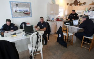 Levreaging The Storm: Ocean City firemen from left: Pat Flynn, Paul Blankley, George Karpinski and Capt. Davie Weeks, wait in the condo across from their station, which was damaged in Hurricane Sandy.  - Dale Gerhard