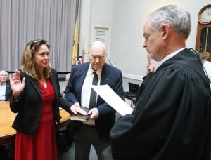 Cape Reorganization: Judge Louis J. Belasco, right, swears in Terri L. Swain to a four-year term as a City Council member Tuesday at City Hall in Cape May. Swain was joined by her father, Bud Swain.  - Photo by Edward Lea
