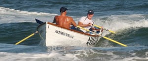 County Lifeguards: Doubles rowing team of Erich Wolf and Greg Whitehead of the Avalon Beach Patrol, guide their boat in to win the doubles race. The Cape May County Lifeguard Championships were held on Rambler Road Beach in Wildwood Crest, with nine county beach patrols participating. Friday July 5, 2013. (Dale Gerhard Photo/Press of Atlantic City) - Dale Gerhard