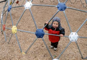 Birch Grove Park: Nicholas Lazos, 18 months old of the Bargaintown section of Egg Harbor Township, enjoying playing on the playground equipment at Birch Grove Park, in Northfield. He was there with his mother and siblings. Monday, March, 18, 2013( Press of Atlantic City/ Danny Drake)  - Danny Drake
