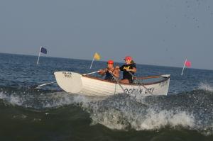 Women Lifeg: Ocean City's Rachel Boudart Holly Berenotto places first in Row / Swim race during Ocean City Beach Patrol Women's Invitational Wednesday, July 24, 2013. - Edward Lea
