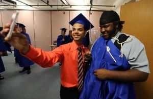 CHARTER TECH. GRADUATION: Carlos Alvira, 18, left of Plesasantville and Charles Ramseur Jr, 19 , right of Absecon takes a selfie photo before the start of Charter-Tech High School Graduation at Tighe School Performing Arts Center in Margate Friday, June 20, 2014. - Edward Lea