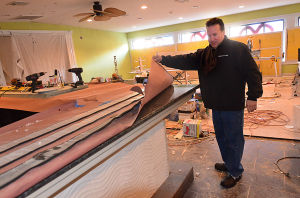 Tale Of Two Restaurants: Johnny Liccio checks the granite top of the new central bar inside the under-construction area beside the original Johnny's Cafe. Johnny's Cafe in Margate is expanding in both directions while neighboring restaurant Fedeli's, a staple in town for decades, is permanently closed.  - Photo by Ben Fogletto