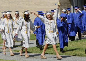 Oakcrest Graduation: Cassie Mancella, 18, of Mays Landing, celebrates as she walks to the graduation ceremony, Friday June 20, 2014, at Oakcrest High School in Mays Landing. - Michael Ein