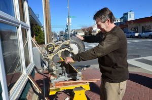 Downtowns In The Velocity Zone: John Pendlebury of Northfield works on renovations to Marketplace Realty on Ventnor Avenue. Monday February 18 2013 Margate's downtown is right in the middle of a bowl-shaped depression that is part of the proposed velocity zone on the new FEMA flood maps - one of the few in the area to do so. (The Press of Atlantic City / Ben Fogletto)  - Ben Fogletto