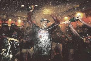 Phils go 5-for-5Clinch fifth straight NL East title
