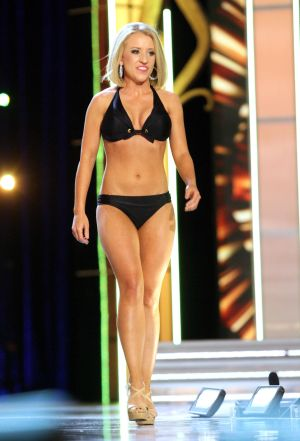 Miss America 2 PRELIMS: Miss Wyoming Rebecca Podio contestant walks the runway during swimsuit portion of the preliminary second round of the Miss America pageant at Boardwalk Hall in Atlantic City, New Jersey, September 11 2013 - Photo by Edward Lea