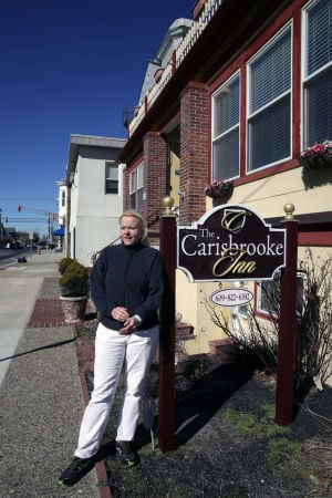 Ventnor Business Probs: Co-owner Agnes Debicz discusses a water meter issue at The Carisbrooke Inn in Ventnor. The bed and breakfast is being charged a water meter fee of $350 for each of its 13 rooms by the city. - Photo by Michael Ein