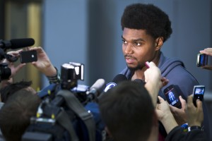 Bynum Photo: 6ers center Andrew Bynum speaks to reporters at the team's NBA training facility Wednesday in Philadelphia.  Bynum remains sidelined with right knee pain and is a longshot to play in the Oct. 31 opener.  - Photo by Matt Rourke