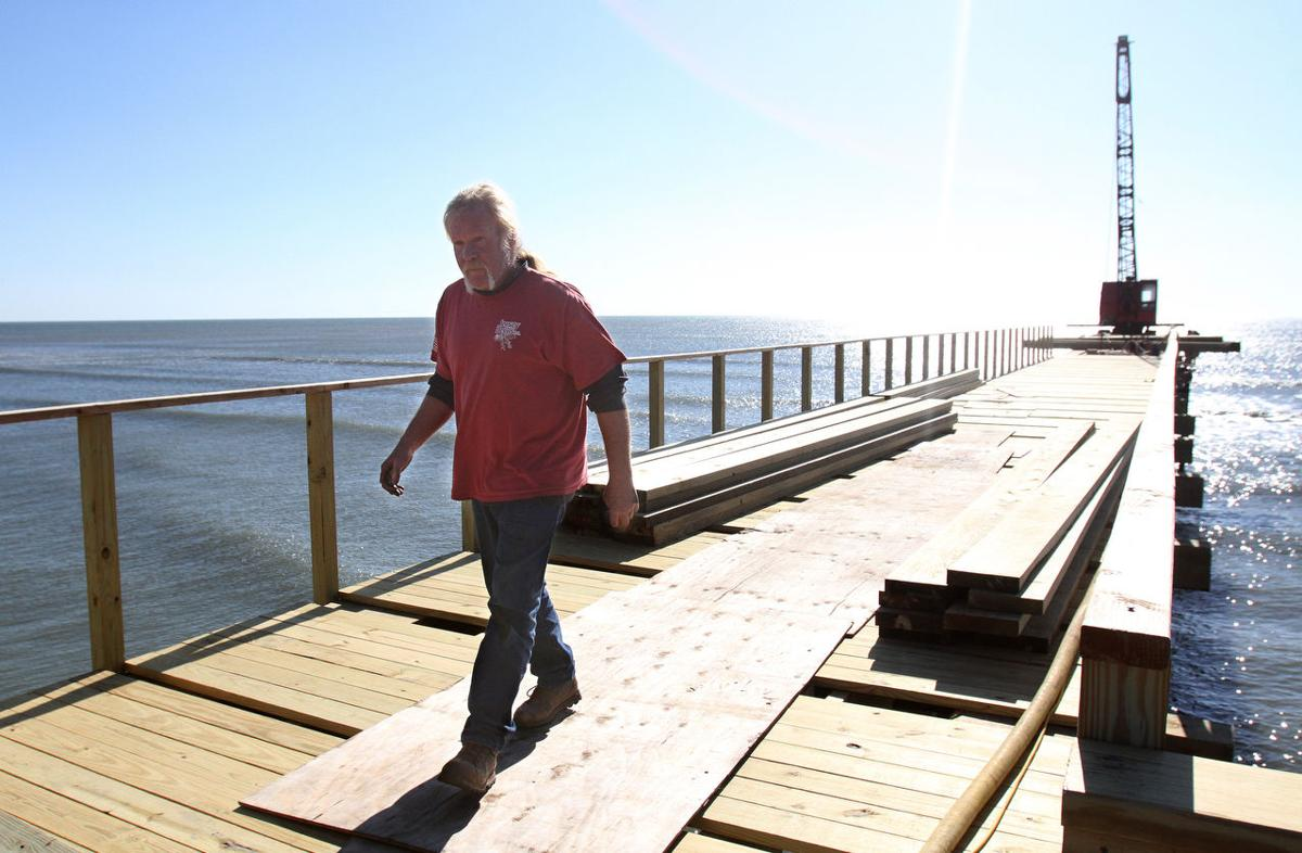 Beach fills leave fishing piers stranded over sand for Atlantic city fishing