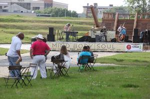 Artandmusic: Spectators listen to the Jost Project perform Wednesday at the Artlantic: Wonder park in Atlantic City. - Press photo by Sean M. Fitzgerald