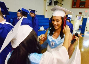 SACRED HEART GRADUATION: Elaine Esteron of Millville (left) fixes the tassel of Ayla Gentiletti of Vineland in the gym before graduation. Monday June 3 2013 Sacred Heart High School Graduation. (The Press of Atlantic City / Ben Fogletto)  - Photo by Ben Fogletto