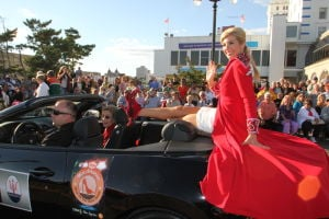 MISS AMERICA PARADE: Miss Arkansas Amy Crain show off her shoe as she waves to during Miss America parade on Atlantic City Boardwalk Saturday. - Edward Lea