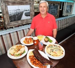 Keeping It In The FamilyNorth End Unites Delicious Food With Fun Atmosphere: Owner JIm Barnabei displays fare at the North End American Grill, including baby back ribs with sweet potato tots, grilled chicken club and nachos.