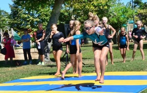 Good Old Days: Briar-Rose Lemma,10 of CMCH demonstrates tumbling on mats from Blake's Gymnastics of Northfield. Saturday September 7 2013 Annual Good Old Days Festival at Kennedy Park in Somers Point benefits the Lawrence Bud Kern Scholarship Fund. (The Press of Atlantic City / Ben Fogletto) - Photo by Ben Fogletto