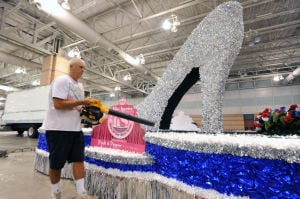 MISS AMERICA PARADE ADVANCE: Joe Langham, of Barton, Md., blows off the lead parade float Friday at the Atlantic City Convention Center ahead of Saturday's Miss America Show Us Your Shoes Parade. - Photo by Michael Ein