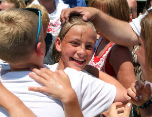 : Girls champion Emily Cavacini 11, of Allegheny Pa,. is congratulated by friends after winning the girls division of the 90th annual National Marbles Tournament held on the beach at Ringer Stadium in Wildwood. Thursday June 20, 2013. (Dale Gerhard/The Press of Atlantic City)  - Dale Gerhard