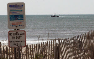 Beach 2: A tow boat sails Off Ocean City in the area where debris was found Thursday that might be linked to a missing boater.  - Dale Gerhard