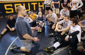Southern Wrestling: Southern Regional wrestling coach John Stout works with team Tuesday. - Photo by Ben Fogletto
