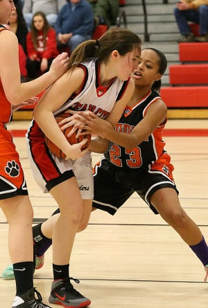 Ocean City Gbb: OC 23 Nicole Piergros and Middle 23 Lauryn Fields fight for the ball during the first half. Monday February 10 2014 Middle Township at Ocean City girls basketball. (The Press of Atlantic City / Ben Fogletto) - Ben Fogletto