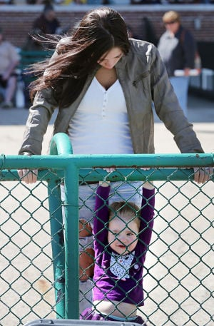 Day At The Races: Amber Piccioni of Elmer NJ watches her daughter, Sophia play by the fence near the track. Sunday April 27 2014 Live turf racing at the Atlantic City Racecourse in Mays Landing. (The Press of Atlantic City / Ben Fogletto) - Ben Fogletto