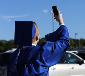 Hammonton High School Graduation: Logan Fiorentino, of Hammonton, takes a selfie before Hammonton High School's graduation, Friday June 20, 2014, in Hammonton. - Michael Ein