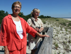 No Rake: Marguerite Chandler (left) and Emelia Oleson, are members of the Cape May Point Environmental Commission and were instrumental in creating an ordinance that bans raking the borough beaches with machines. Beach tag checkers are now in charge with picking up trash from the beach to preserve natural conditions on the beach. Wednesday Sept. 04, 2013. (Dale Gerhard Photo/Press of Atlantic City)a - Dale Gerhard