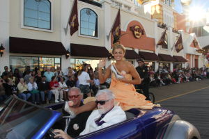 MISS AMERICA PARADE: Miss Georgia Carly Mathis show off her shoe as she waves to during Miss America parade on Atlantic City Boardwalk Saturday. - Edward Lea
