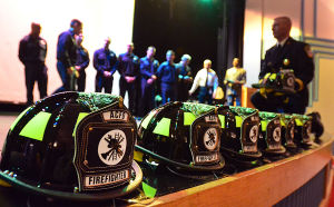 Acfd Staffing: New Atlantic City firefighters approach to receive their helmets during a ceremony in March at Atlantic City High School. - Staff photo by Ben Fogletto, March 1, 2013