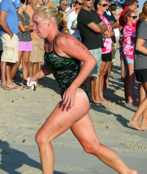 : Stone Harbor's Hayley Edwards, sprints to the finish after the swim. Cape May Point Women's Lifeguard Challenge, a short run-paddleboard-swim triathlon for women lifeguards Monday July 29, 2013. (Dale Gerhard Photo/Press of Atlantic City) - Dale Gerhard