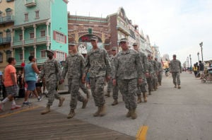 AC Salutes Armed Forces Parade: The National Guard 57th troop command from Atlantic City marches in the Atlantic City Salute Armed Forces parade on the Atlantic City Boardwalk, Monday June 24, 2013  - Vernon Ogrodnek
