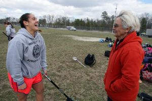 Millville Girls Lacrosse Practice: Millville lacrosse player Corrine Etter, left, talks to her grandmother, longtime coach Claudia McCarthy, during practice Wednesday, March, 27, 2013.  - Edward Lea