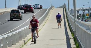 BIKING ROUTE 52: Saturday July 13 2013 Jeff Pisarek of Ocean City uses the bike path on the Route 52 Causeway Bridge between Somers Point and Ocean City. (The Press of Atlantic City / Ben Fogletto) - Ben Fogletto
