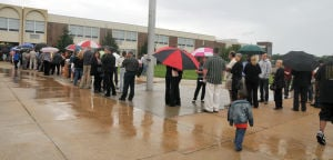 Buena Graduation: Parents, friends, and family, wait in the rain to enter the school during Buena Regional High School's Graduation ceremony held at Buena Regional High School in Buena Vista Township Tuesday, June 18, 2013. Photo/Dave Griffin  - Photo by David Griffin