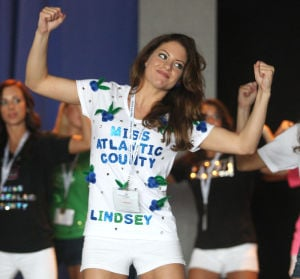 : Miss Atlantic County Lindsey Giannini of Hammonton, rehearses on stage at the Music Pier. Contestants for this year's Miss New Jersey Pageant in Ocean City Music Pier, arrived in town and began rehearsal for pageant which begins on Thursday. Tuesday June 11, 2013. (Dale Gerhard/The Press of Atlantic City)  - Dale Gerhard